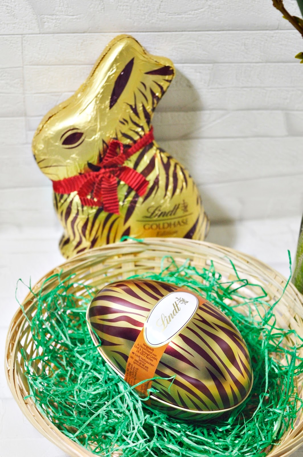 Easter bunny wears Animal Print Metall Egg with Nougat Egss
