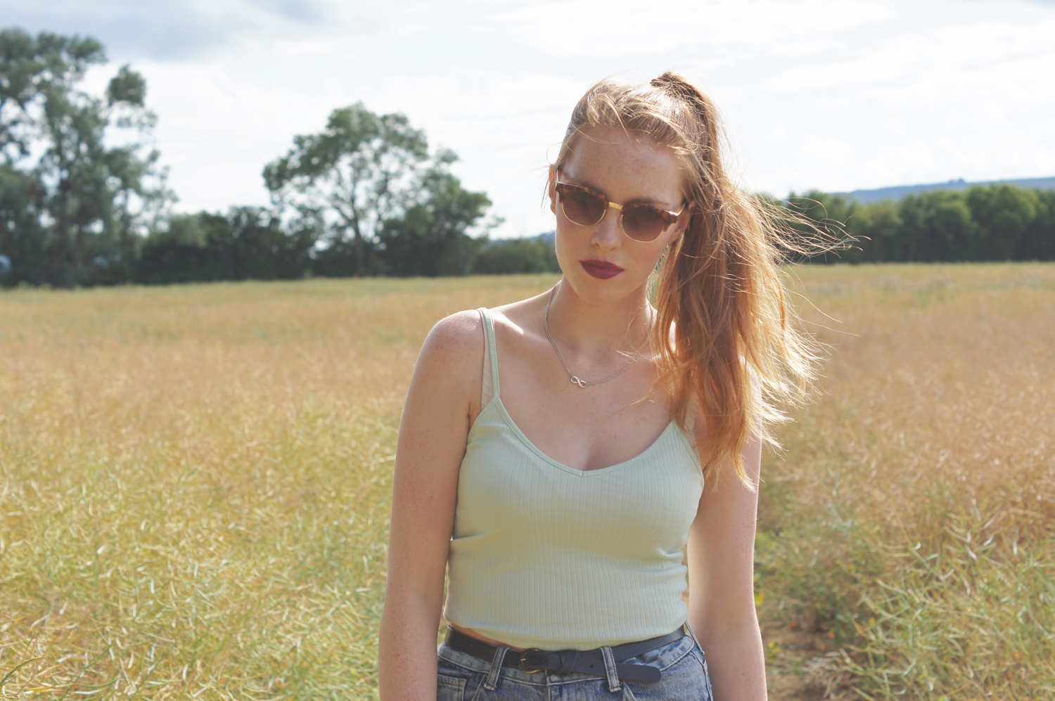 pastel strappy crop top and ray ban