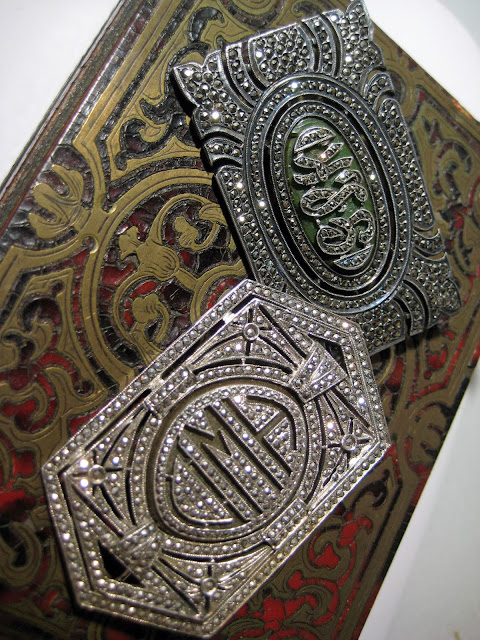 Art Deco marcasite monogram brooches.