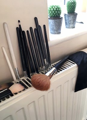 make-up brushes drying on radiator