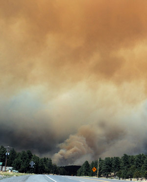 Smoke billows from the Little Bear fire near Ruidoso, NM