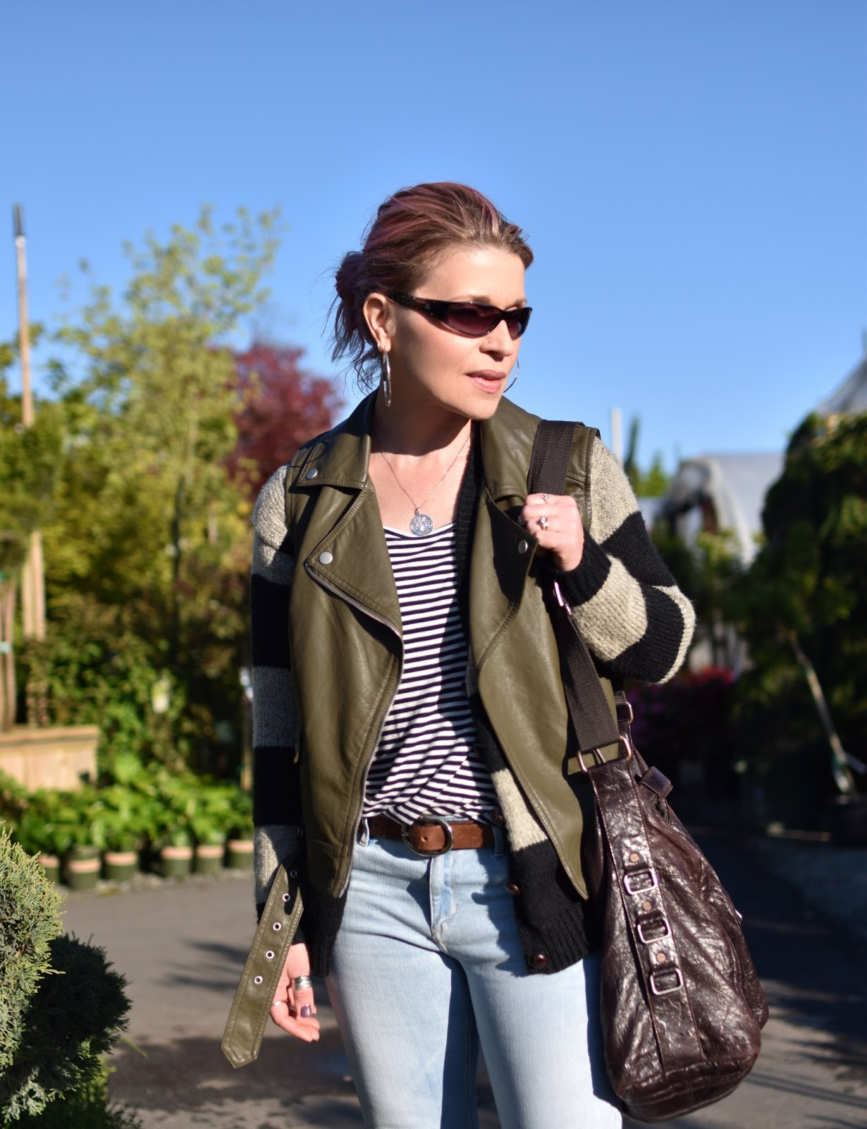 Monika Faulkner outfit inspiration - striped tee, striped cardigan, olive moto vest, sunglasses, matt & nat bag