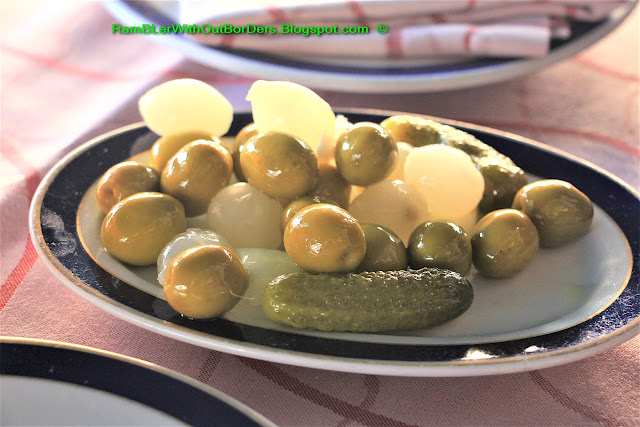 Pickled onion, dill and olive, Taberna Real, Plaza Isabella II, Madrid, Spain