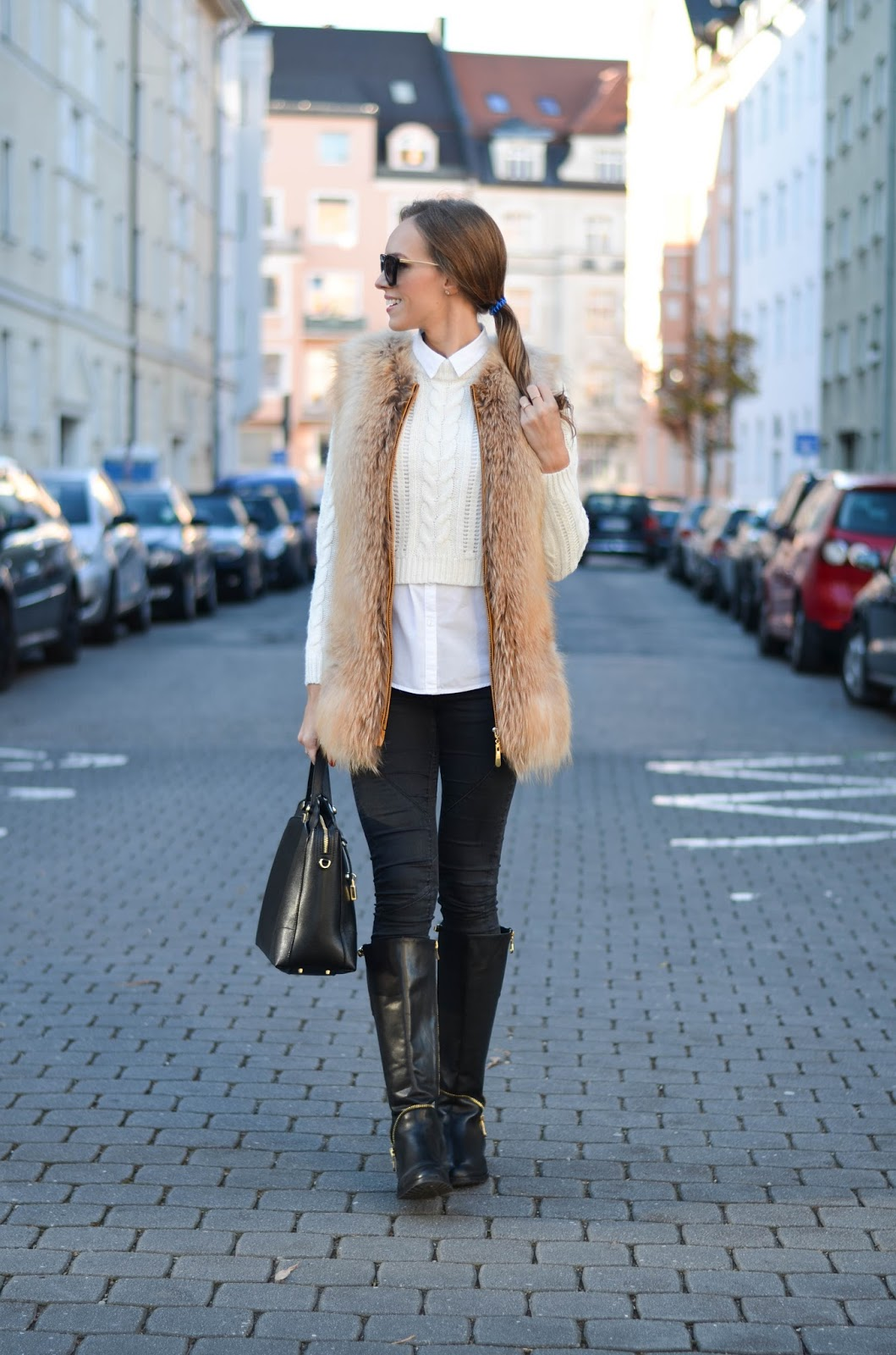 kristjaana mere fur vest white jumper black skinny jeans knee boots winter fashion