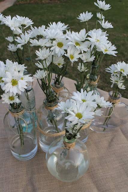 daisies in glass vases