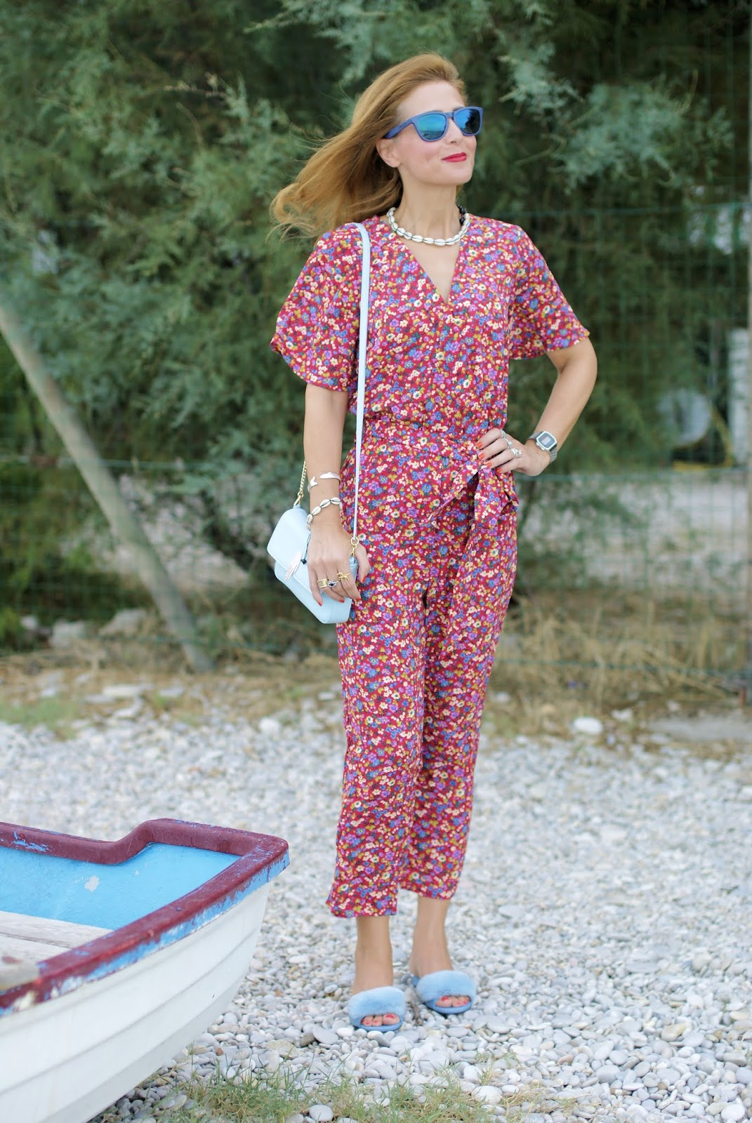 Floral jumpsuit and baby blue furry slippers on Fashion and Cookies fashion blog, fashion blogger style