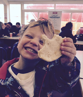 Picture of child holding a dirty burger from Wimpy