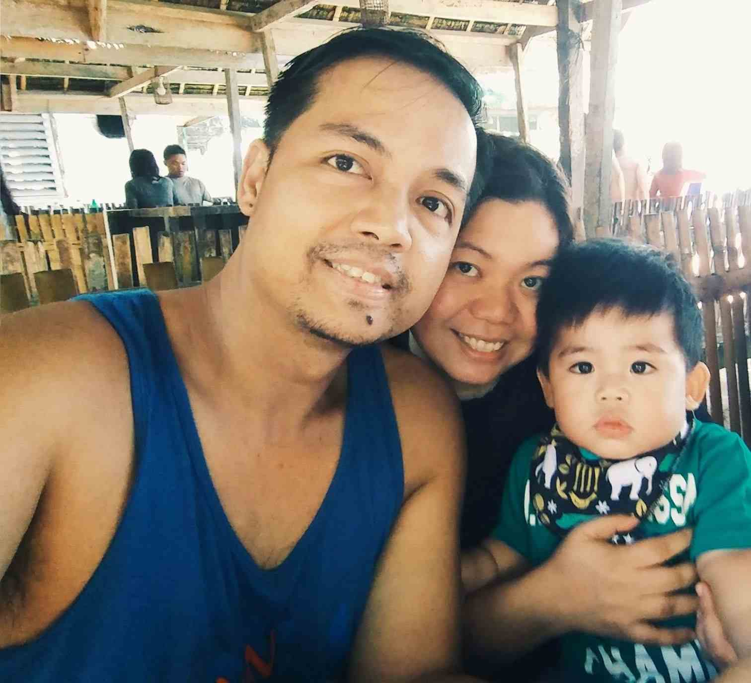 Our family photo while we were at our cottage at Dumaluan Beach Resort in Bohol