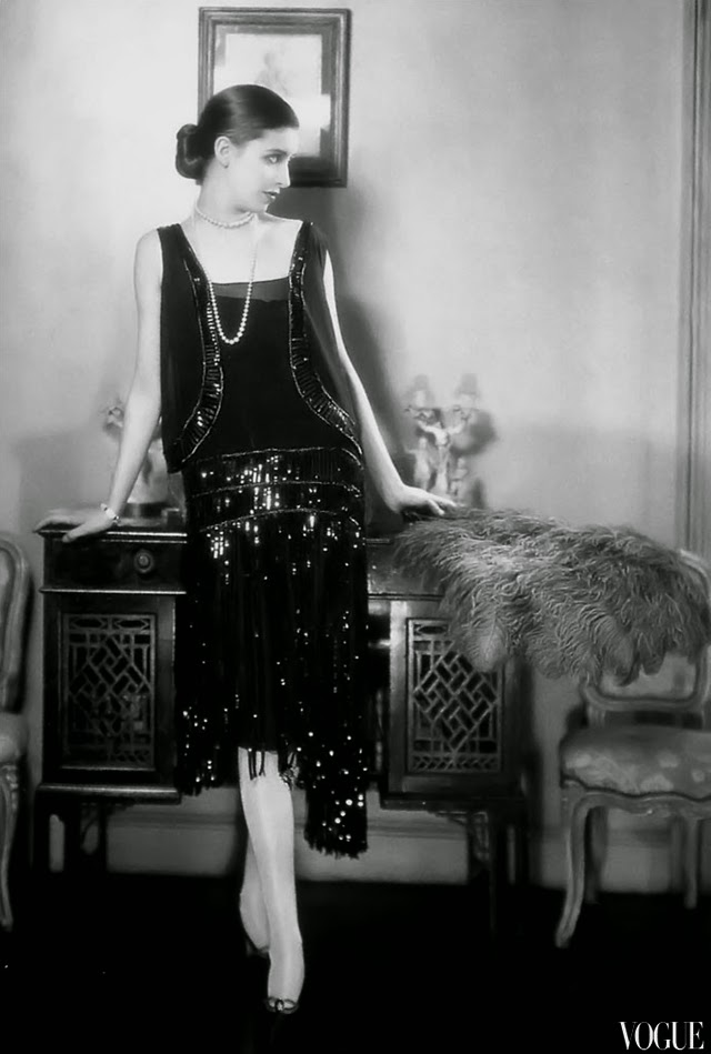 Model and photographer marion morehouse is wearing black sequined dress by chanel vogue 1926