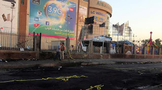At least 13 people lost their lives in Two bomb blasts at a shopping mall in Central Baghdad