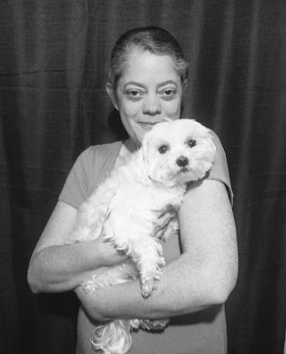 B&W photo of Charity Rowell with Lexi the Maltese
