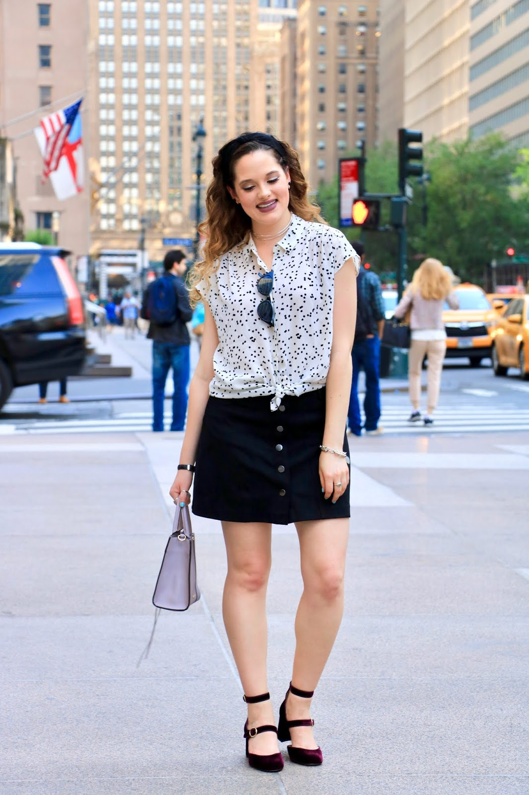 Nyc fashion blogger Kathleen Harper showing how to wear a black mini skirt