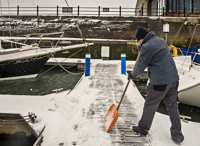 Photo of Phil clearing the snow from the pontoon leading to Ravensdale