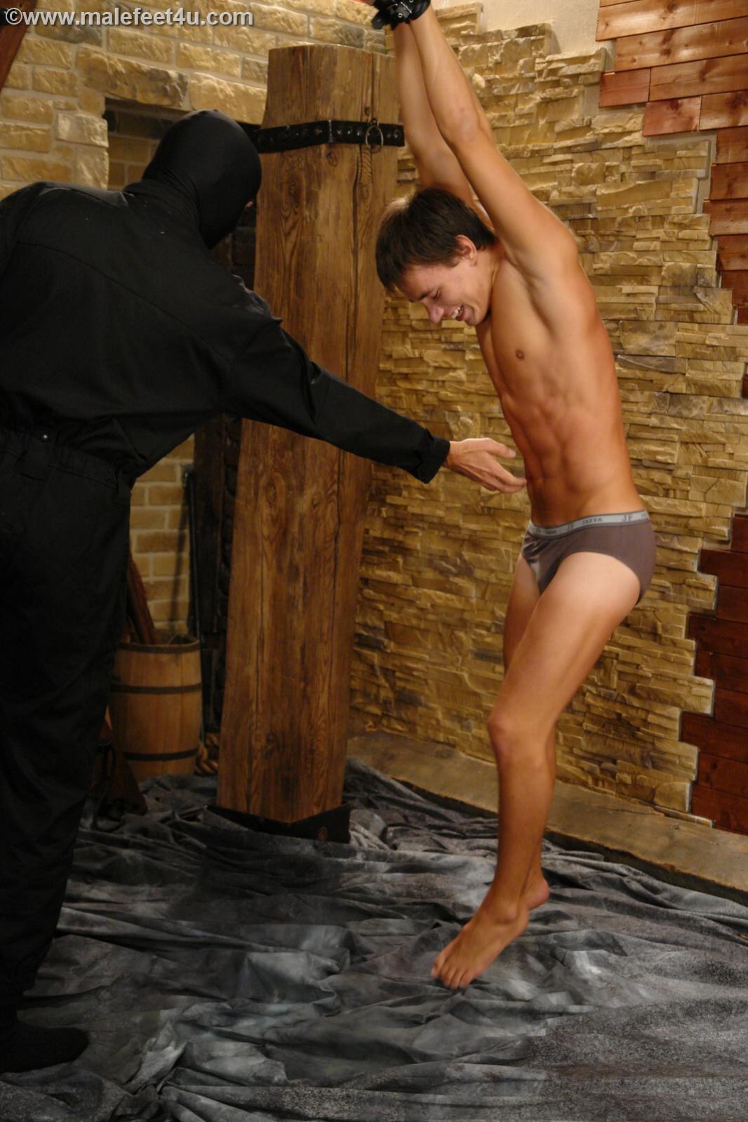 Boy tied naked