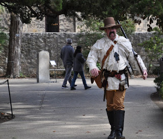 Man in period American Frontier clothing at the Alamo