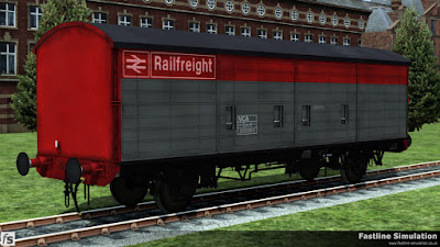 Fastline Simulation: A VCA in sparkling Railfreight flame red and grey livery stands outside of the works.
