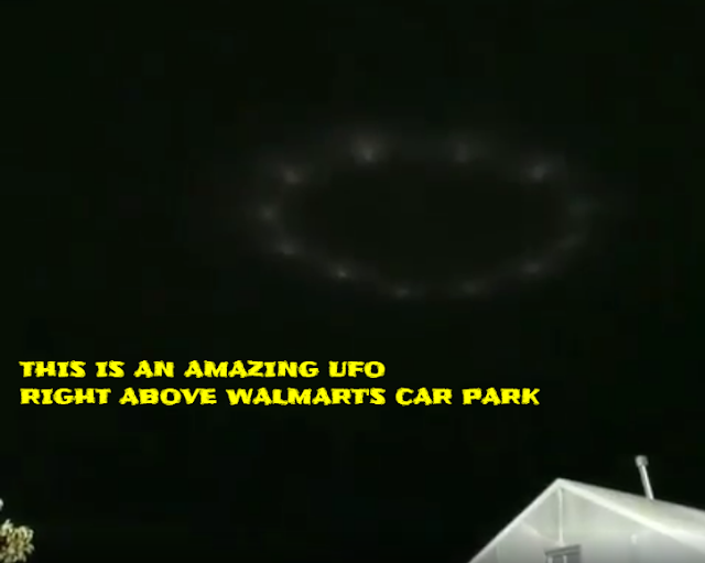 The UFO above Walmart just hovers above the families heads.