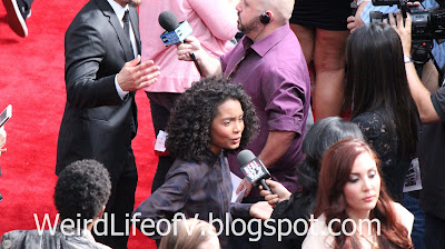 Yara Shahidi being interviewed on the red carpet - Jurassic World Premiere