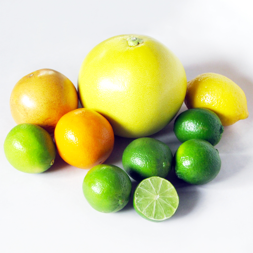 Clockwise from center: pomelo, lemon, limes, juicing orange, white grapefruit.