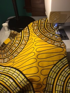 Bright yellow Ankara fabric in a circle design pattern