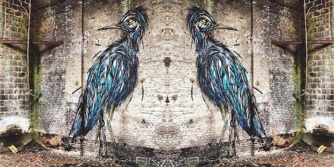 dos aves en una pared vieja - arte urbano