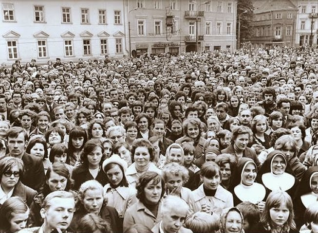 Living Sound Team II Sacrosong Concert Crowd, Przemysl, Poland, Sep. 22, 1975. According to Michael McKibben, an estimated 20,000 people jammed the streets to hear Living Sound, They set up their musical gear on a specially built stage from which this picture was captured. Cardinals Karol Woytła was the patron of Sacrosong. McKibben said he was approached by a known Polish secret policeman during this concert before the sponsoring parish priest told the man to leave Living Sound alone