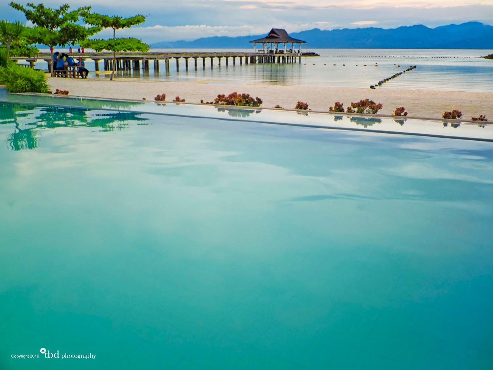 Infinity Pool With The Scenic Ocean And Mountains In Background At Secdea