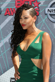 Meagan Good with long black goddess locs with shaved side