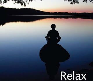 A person sitting in a calm place for meditation, relaxation.