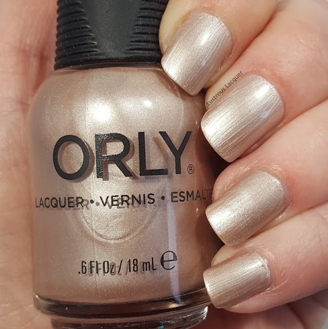Sandy Champagne colored nail polish with a pearl finish from the Pastel City Collection