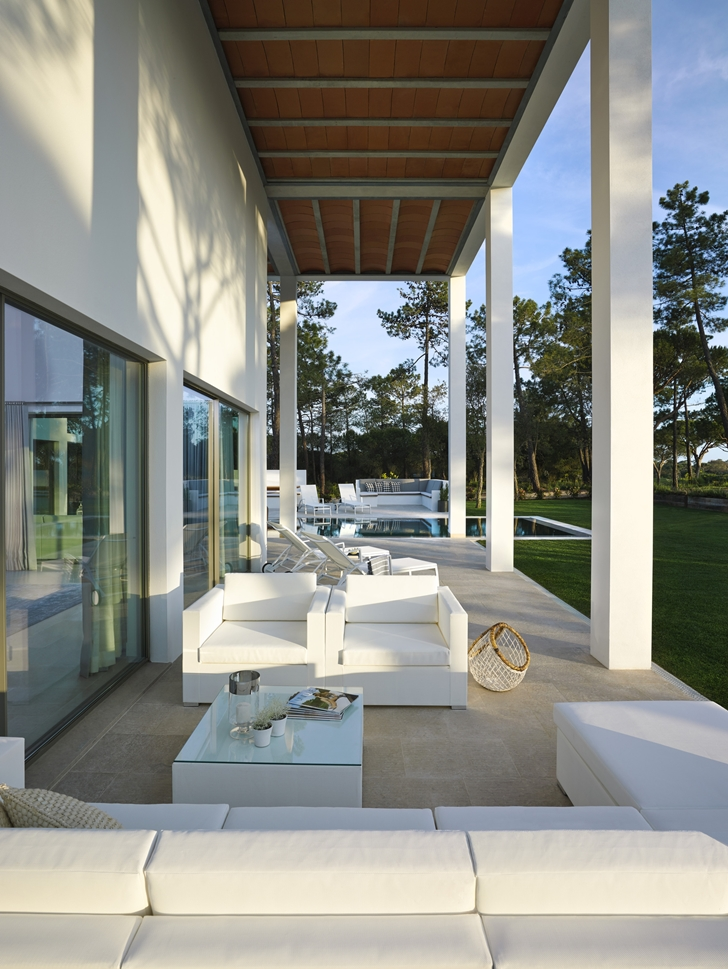 White terrace furniture in Simple modern home in Portugal