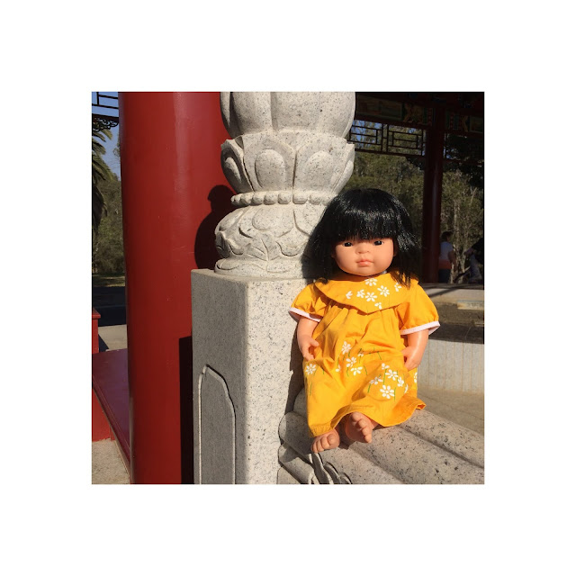 Elegant Asian Miniland Doll at The Chinese Gardens