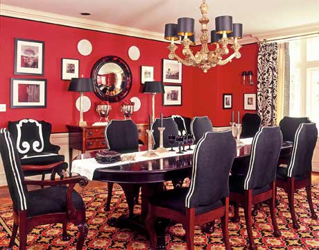 Here Is A Room That Has RED Walls The Black Upholstered Furniture Calms Red And Makes For Dining Comfortable Little Masculine