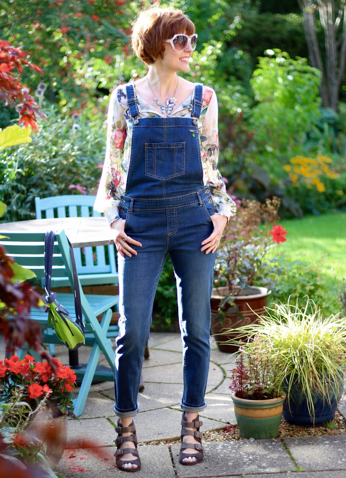 Fake Fabulous | Blue denim dungarees, floral chiffon blouse, buckle strap sandals... over 40!