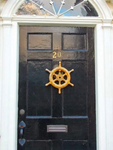 front door with shipwheel