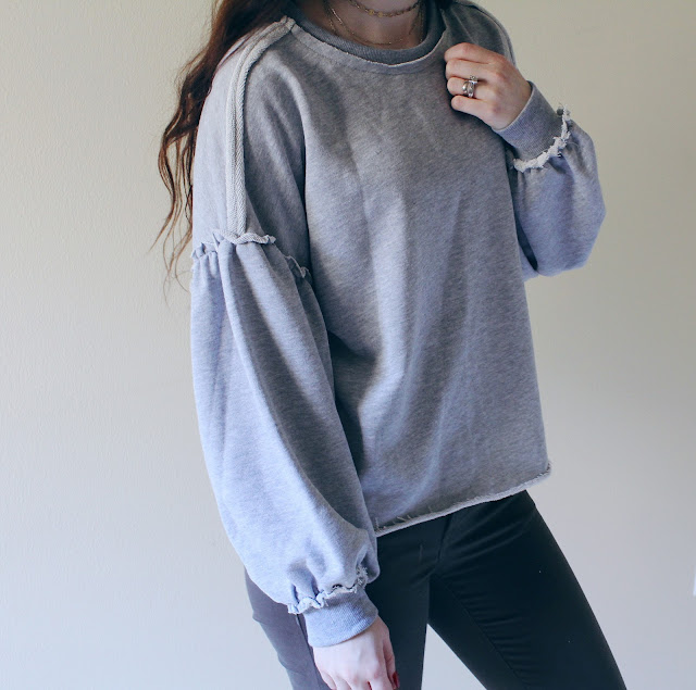cozy exposed hem sweatshirt