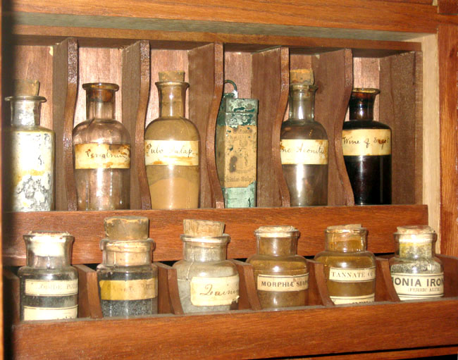 small medicine bottles inside little wooden compartments on autenrieth wagon