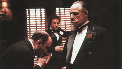 Marlon Brando as Don Vito Corleone, Bonasera kisses Don Vito Corleone's hand, accepts him as his Godfather, James Caan as Sonny Corleone, Directed by Francis Ford Coppola