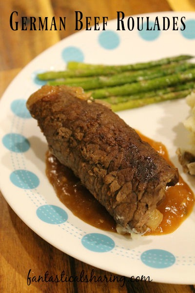 German Beef Roulades // These perfect little roulades hide away bacon, onions, and a pickle served with mashed potatoes and gravy #recipe #SecretRecipeClub #roulades #beef #German