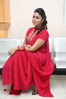 Actress Poorna Latest Stills in Red Dress at Rakshasi First Look Launch  0245.JPG