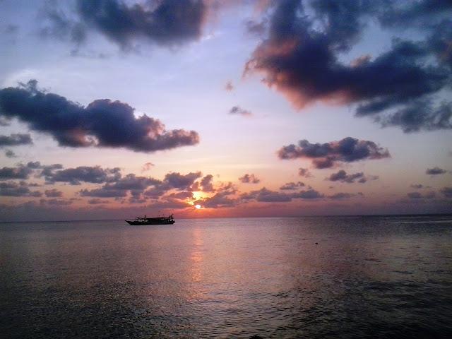 sunset pulau enu