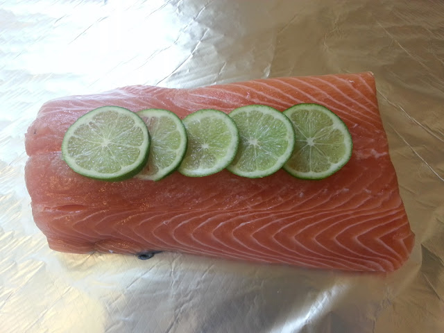 Uncooked Salomn Fillet with Lime Slices