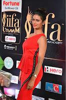 Meenakshi Dixit in Red One Shoulder Red Zipped up gown at IIFA Utsavam Award 11.JPG