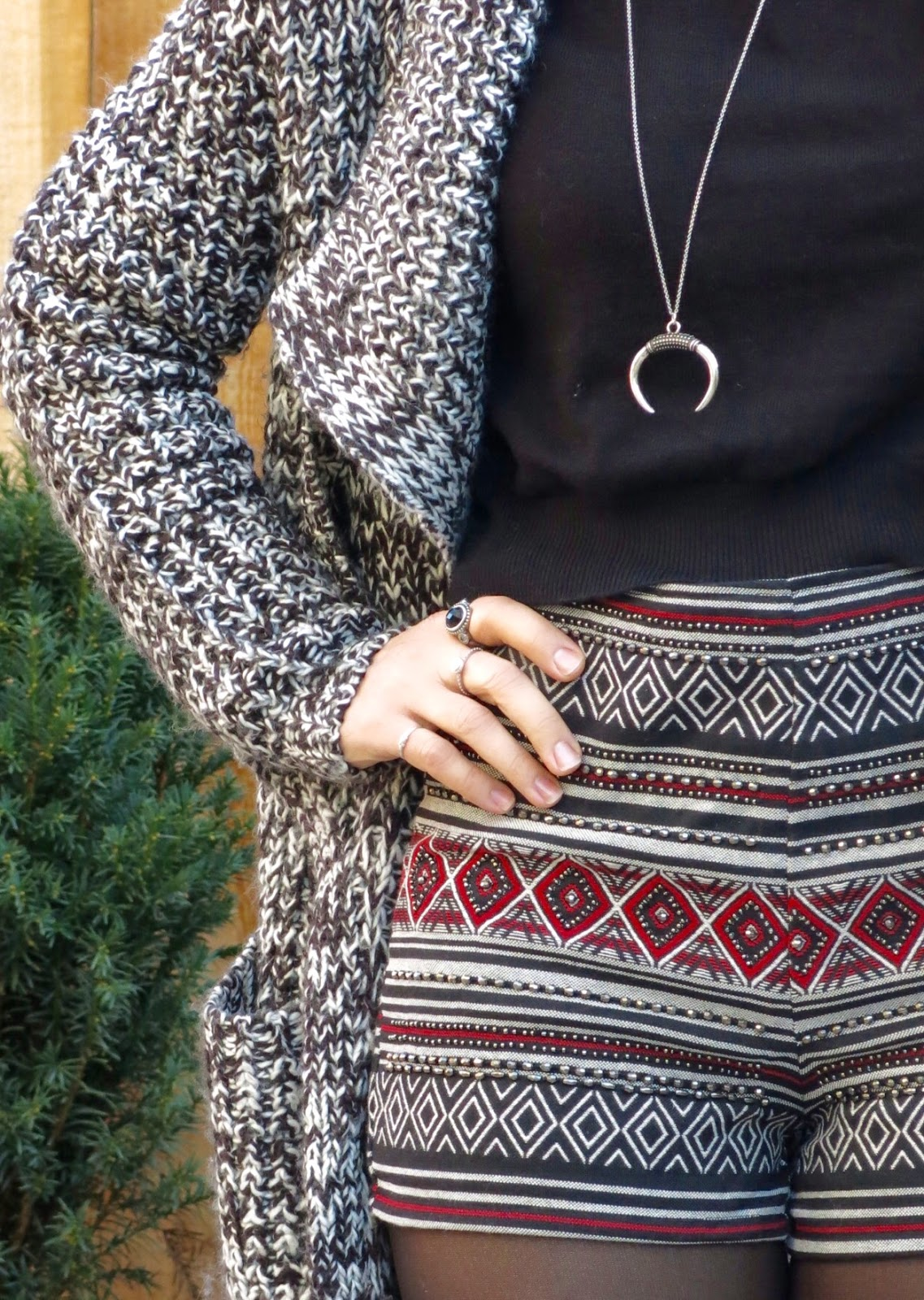 embellished shorts, cropped sweater, and long cardigan