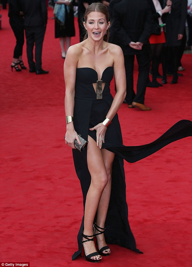 The models dress had a high slit up her left leg, showing