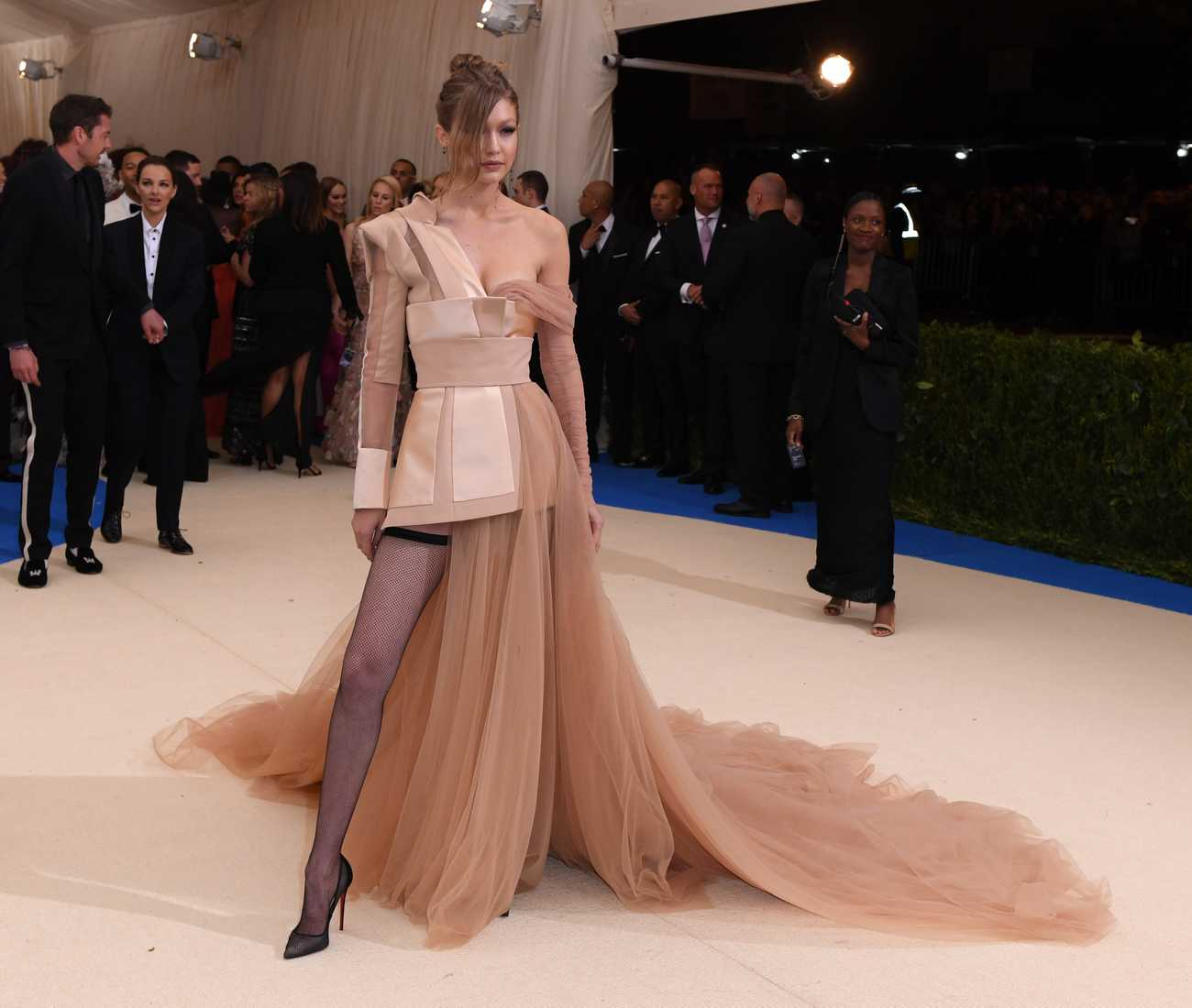 Gigi Hadid flashes her fishnets in princess-inspired Tommy Hilfiger gown as she goes to Met Gala without Zayn Malik