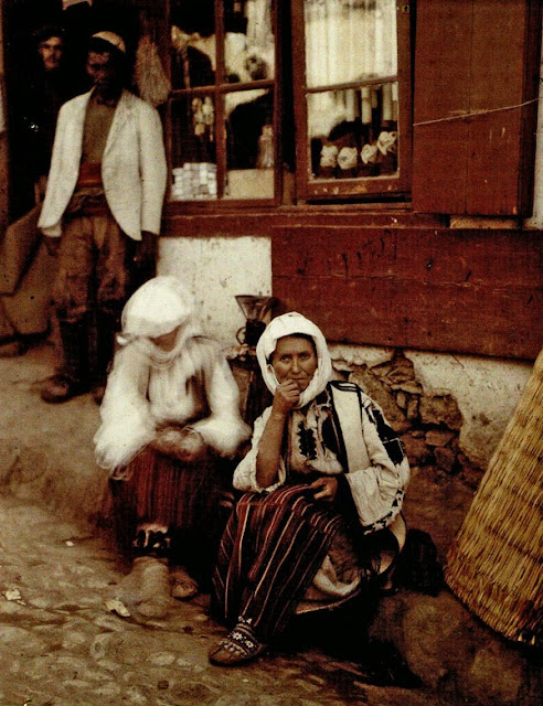 Two women from the Skopska Crna Gora (mountain area, about ten kilometers northwest of Skopje) sell mats. They wear the traditional dress of this region. - Macedonia in 1913