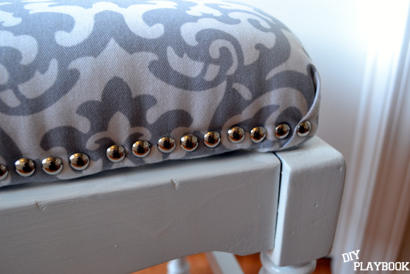 Silver Nailhead trim on bench cushion white bench
