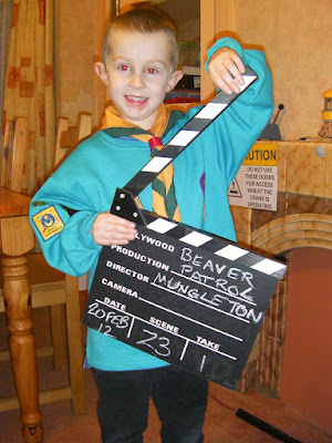 beaver scout uniform and film clapperboard