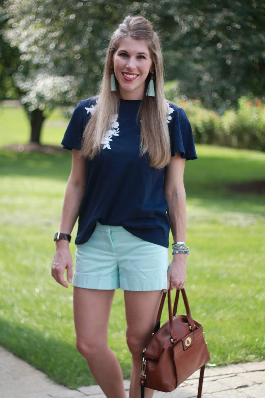 navy embroidered top, mint shorts, crystal studded sandals